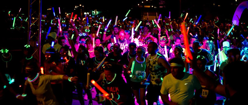 Everybody at the glow run wearing glow bracelets and merchandise